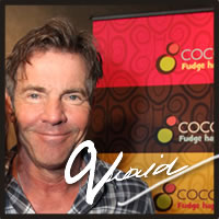 Dennis Quaid tasting Cocopotamus' gluten free chocolate truffles at the Emmys