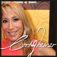 Lori Greiner tasting gluten free chocolate at the Emmys